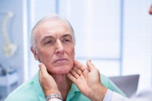 elderly man getting examined by chiropractor