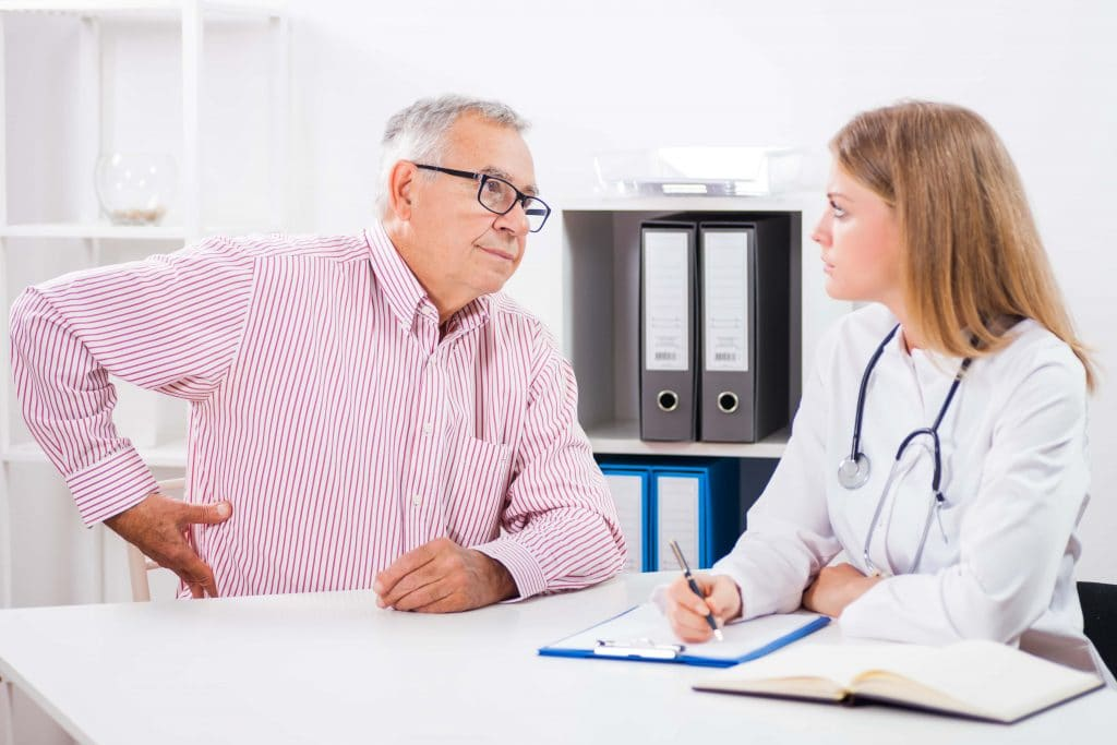 patient and doctor speaking to each other