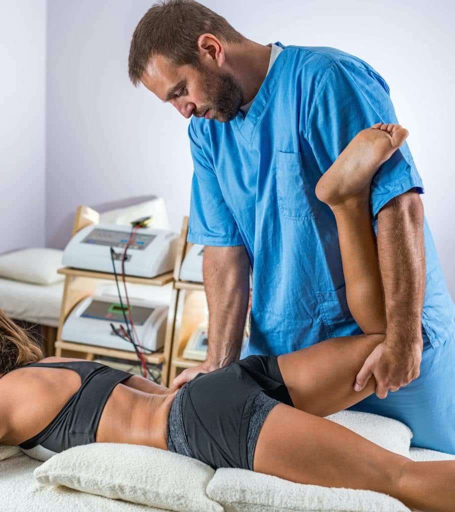 Chiropractor adjusting patients hip
