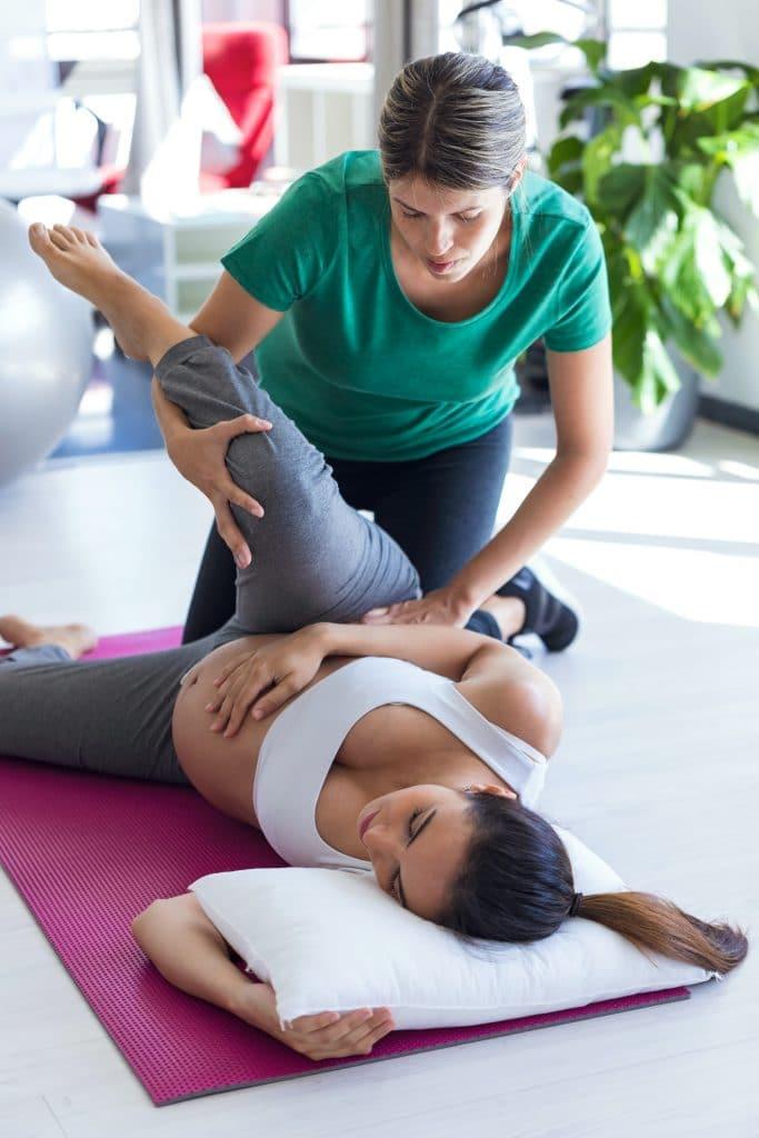 chiropractor adjusting pregnant patient