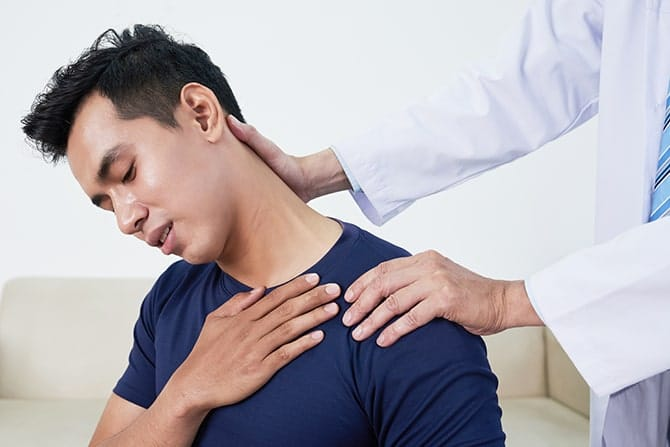 Patient receiving chiropractic treatment at Allied Pain & Wellness